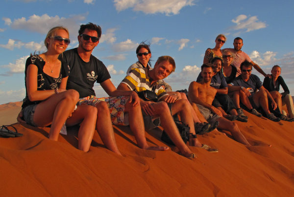 Sitting on top of Dune 45 Namib Desert Namibia