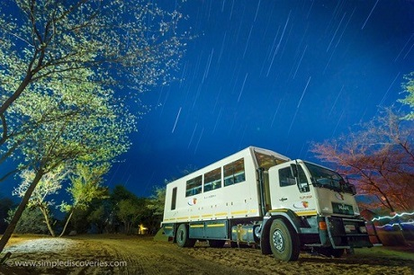 Watching the stars dance above our overland vehicle in Botswana.