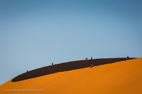 Some of our overland adventure team celebrating the summit of Dune 45 in Sossusvlei, Namibia.