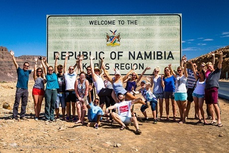 Our diverse overland adventure team crossing the border from South Africa into Namibia.